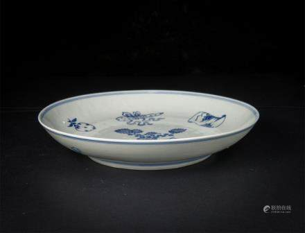 A Blue And White Dish with Precious Emblems