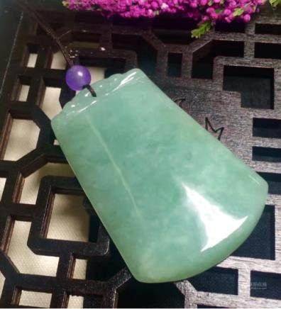 A NATURAL NO DESIGN JADEITE SCULPTE