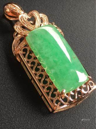 A NATURAL SADDLE-SHAPED DOULV JADEITE PENDANT