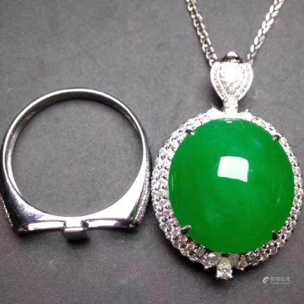 A NATURAL EGG-SHAPED YANGLV JADEITE RING/PENDANT