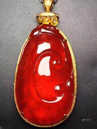 A NATURAL RUYI DESIGN RED JADEITE PENDANT