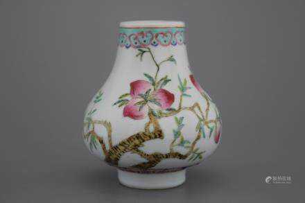 A Chinese porcelain famille rose small nine peaches vase, 19th C.