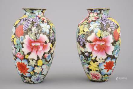 A pair of Chinese porcelain millefleurs black ground vases, ca. 1900