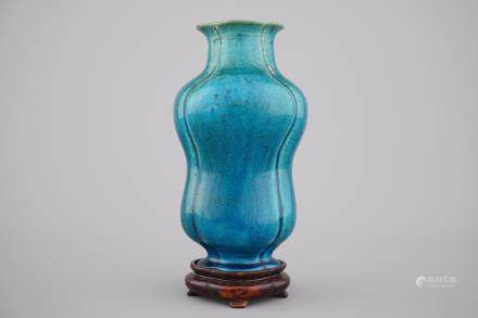 An unusual Chinese turquoise monochrome vase on carved wood stand, 18th C.