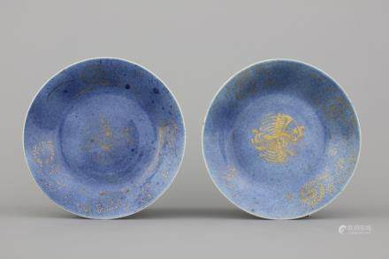 A pair of Chinese porcelain powder blue and gilt plates, 18th C.