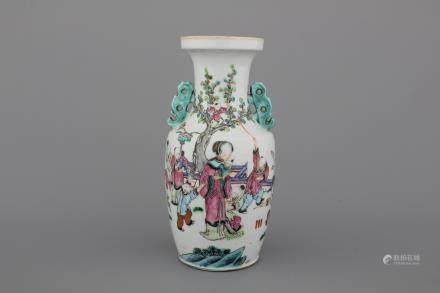 A Chinese porcelain famille rose vase with a garden scene, 19th C.