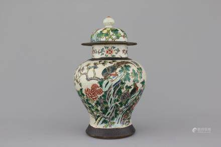 A Chinese porcelain famille verte Nanking vase and cover, 19th C.