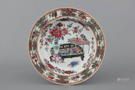 A Chinese porcelain famille rose plate with an interior, Yongzheng, 18th C.