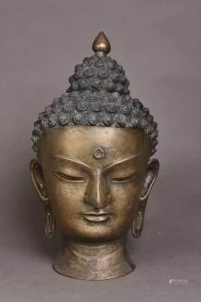 A BRONZE OF SAKYAMUNI BUDDHA HEAD