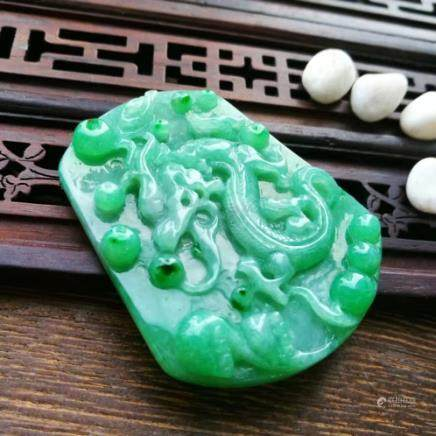 A DRAGON DESIGN NATURAL  ICY JADEITE PENDANT WITH CERTIFICATE