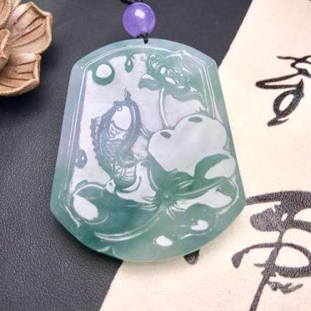 A FISH& LOTUS DESIGN  NATURAL ICY JADEITE PENDANT WITH CERTIFICATE