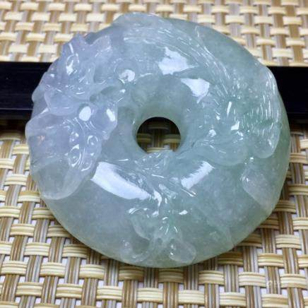 A  NATURAL ICY JADEITE PENDANT WITH CERTIFICATE