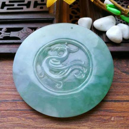A PHOENIX DESIGN NATURAL ICY JADEITE PENDANT With certificate