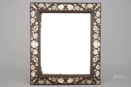 "A ""Bois de Spa"" mother of pearl, stained horn, and brass inlaid mirror frame, 17th C."