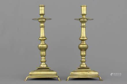 A pair of Spanish bronze candlesticks on triangular bases, 17th C.