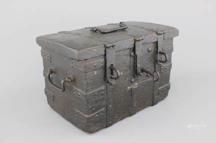 A cast iron and wood strong box, 17th C., The Netherlands