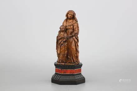 A carved boxwood figure of Saint-Anna and the Virgin, ca. 1600