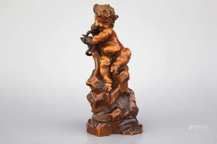 A carved boxwood figure of Hercules with a snake, ca. 1620