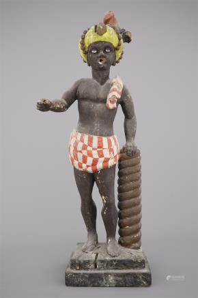 A large painted wood figure of a blackamoor or Indian, Dutch, 18th C.