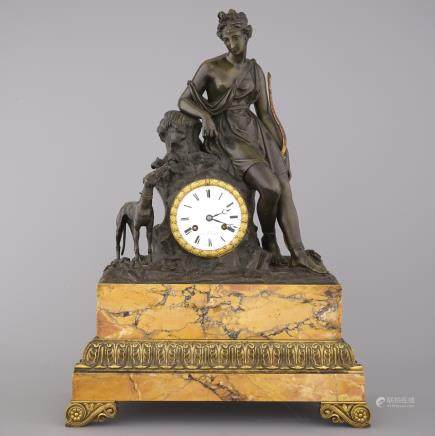 A large French Empire gilt and patinated bronze pendule, early 19th C.