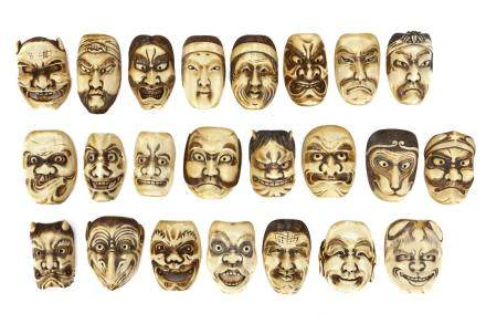 A COLLECTION OF MINIATURE IVORY MASKS