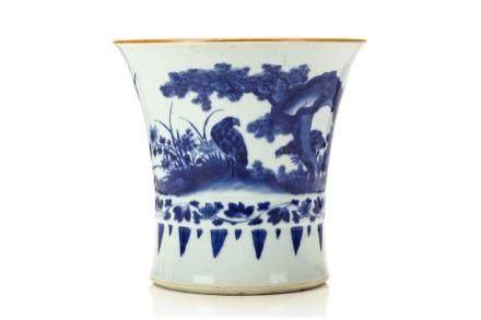 A CHINESE BLUE AND WHITE BEAKER VASE