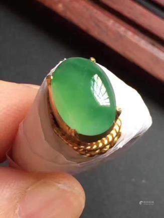 A NATURAL OVAL-SHAPED MANLV JADEITE CABOCHON