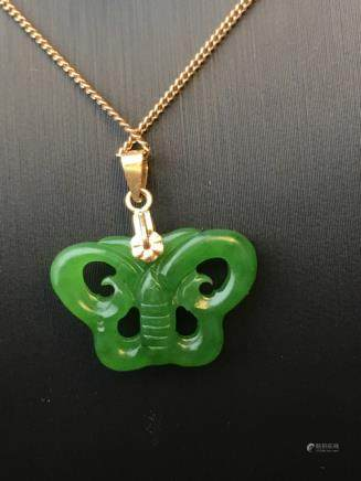 A NATURAL BUTTERFLY-SHAPED HETIAN GREEN JADE PENDANT