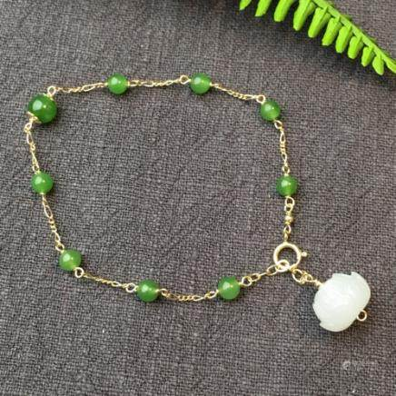 A NATURAL BEADS HETIAN GREEN JADE BRACELET