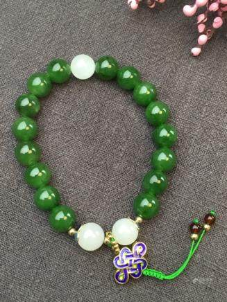 A NATURAL BEADS HETIAN GREEN JADE BANGLE