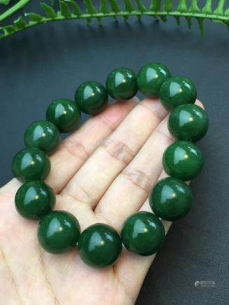 A NATURAL 14 BEADS HETIAN GREEN JADE BRACELET