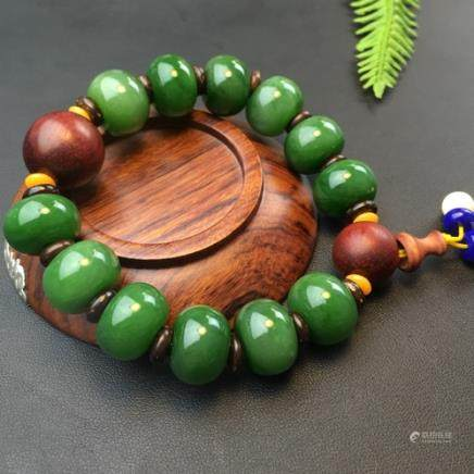 A NATURAL 12 BEADS HETIAN GREEN JADE BRACELET