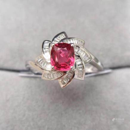A NATURAL 18K RED SPINE RING