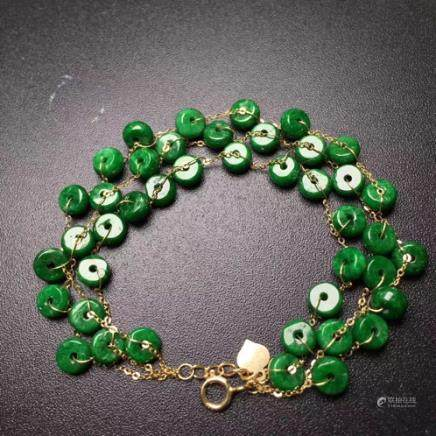 A NATURAL COIN-SHAPED JADEITE BEADS 18K BRACELET