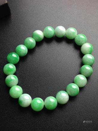 A NATURAL PIAOCUILV JADEITE BEADS BRACELET