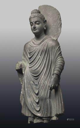 An Important Gray Schist Figure of a Standing Buddha