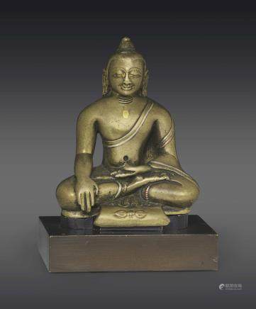 A SILVER- AND COPPER-INLAID BRONZE FIGURE OF BUDDHA SHAKYAMUNI
