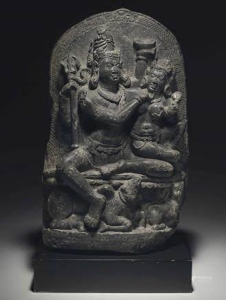 A black stone stele of Umamaheshvara