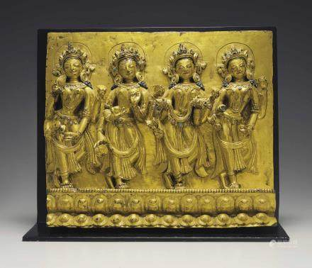 A Densatil Gilt Bronze Frieze with Offering Goddesses