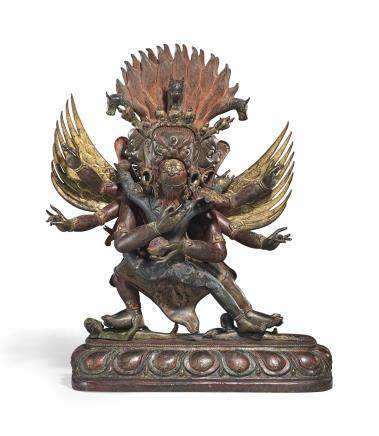 A gilt and polychomed cast and repousse copper alloy figure of Hayagriva