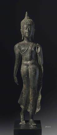 A Rare Bronze Figure of a Walking Buddha