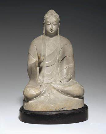 A WHITE MARBLE FIGURE OF SEATED BUDDHA