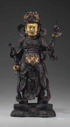 A LACQUERED AND GILT-BRONZE FIGURE OF A GUARDIAN KING