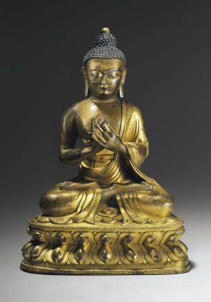 A PARCEL-GILT BRONZE FIGURE OF BUDDHA