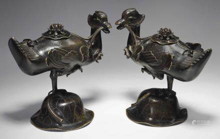 A PAIR OF BRONZE DUCK-FORM CENSERS AND COVERS