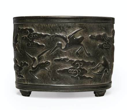 A BRONZE CYLINDRICAL CENSER WITH CRANES