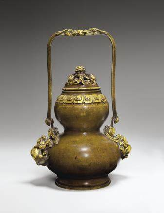 A RARE PARCEL-GILT-BRONZE DOUBLE-GOURD HANGING CENSER AND COVER