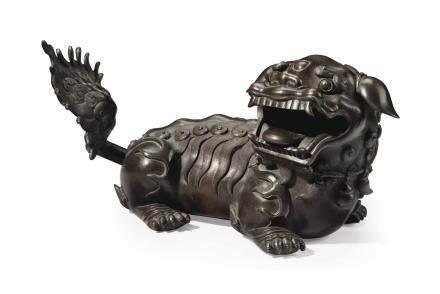 A BRONZE FIGURE OF A BUDDHIST LION