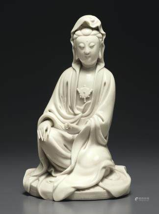 A DEHUA FIGURE OF GUANYIN WITH A SCROLL