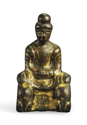 A SMALL EARLY GILT-BRONZE FIGURE OF SHAKYAMUNI BUDDHA
